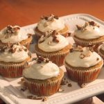 pumpkin cupcake topped with maple syrup